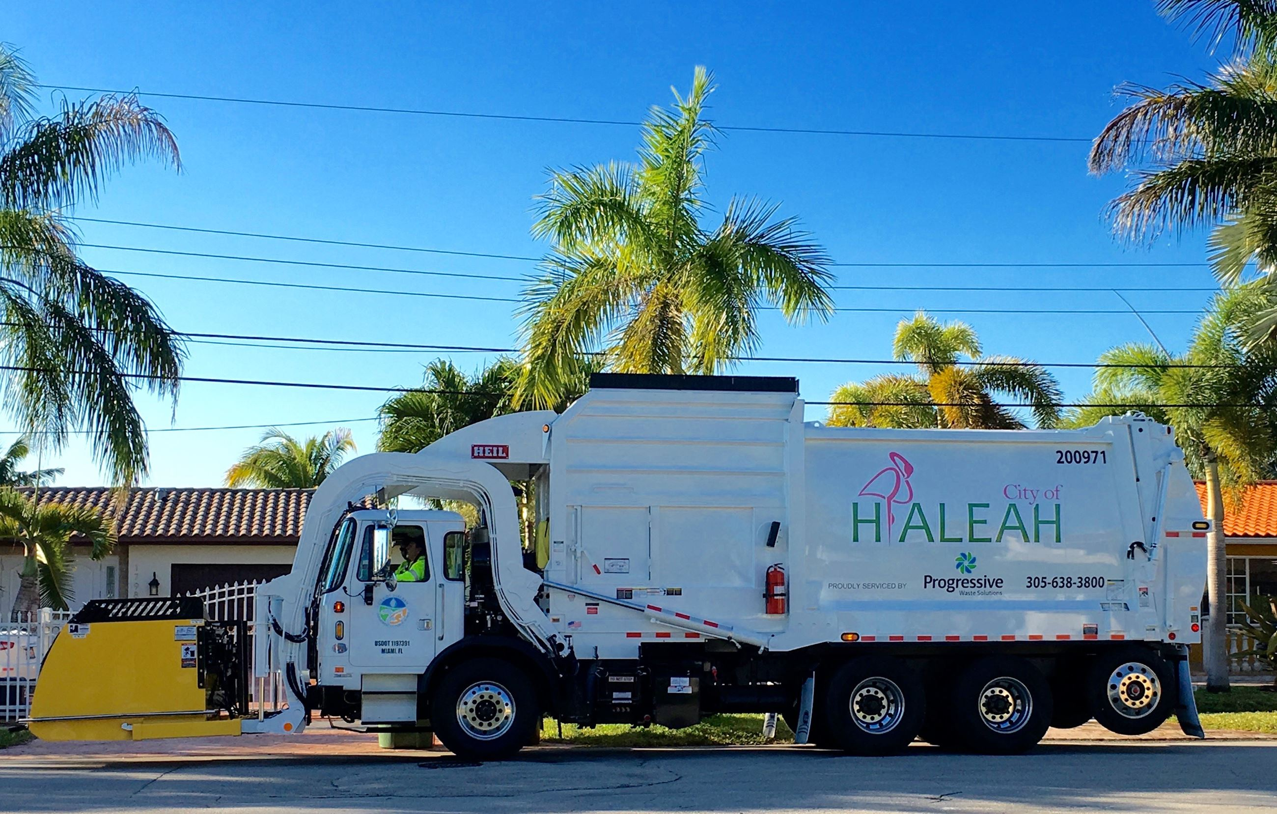 Hialeah white garbage truck side view