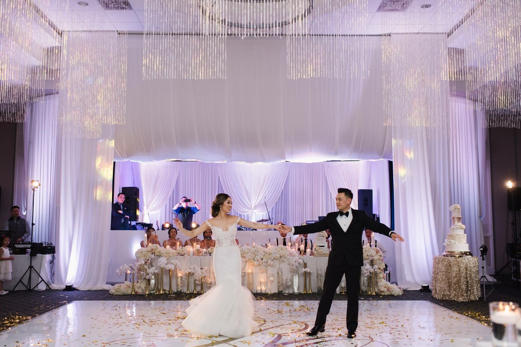 A bride and groom dance