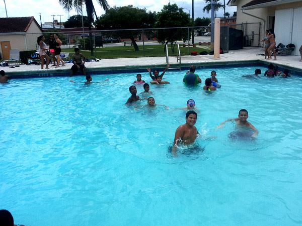 Parents and kids enjoying  public swimming
