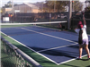 Girl practices serving during the Goodlet Tennis program