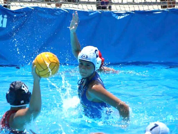 Water Polo meet defender blocking shot from other team